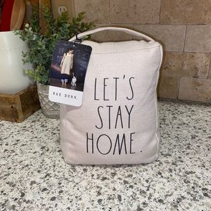 """Rae Dunn """"Let's Stay Home"""" Pillow Doorstop"""